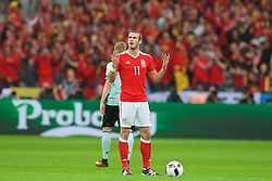 LILLE, FRANCE - Friday, July 1, 2016: Wales' Gareth Bale gestures to his team mates to during the UEFA Euro 2016 Championship Quarter-Final match against Belgium at the Stade Pierre Mauroy. (Pic by Paul Greenwood/Propaganda)
