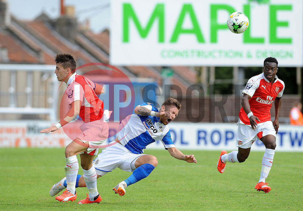 Matty Taylor of Bristol Rovers on the receiving end of a strong challenge by Arsenal's Julio Pleguezuelo - Photo mandatory by-line: Neil Brookman/JMP - Mobile: 07966 386802 - 18/07/2015 - SPORT - Football - Bristol - Memorial Stadium - Pre-Season Friendly