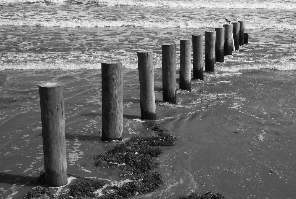 Pilings at Fourchon Beach -- These pilings mark an unauthorized land grab blocking off what is a public beach.