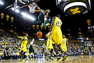 Feb 23, 2014; Ann Arbor, MI, USA; Michigan State Spartans forward Adreian Payne (5) dunks in the second half against the Michigan Wolverines at Crisler Arena. Michigan 79-70. Mandatory Credit: Rick Osentoski-USA TODAY Sports