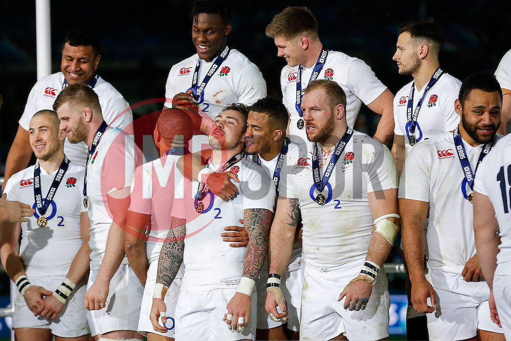 England Winger Jack Nowell and Winger Anthony Watson celebrate after winning the match to complete their Six Nations title with the Grand Slam - Mandatory byline: Rogan Thomson/JMP - 19/03/2016 - RUGBY UNION - Stade de France - Paris, France - France v England - RBS 6 Nations 2016.