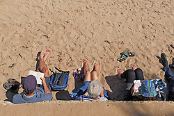 © Licensed to London News Pictures. 22/05/2019. Dorset, UK. People relax on the beach in Swanage Bay on a hot sunny day in Dorset, UK. Photo credit: LNP