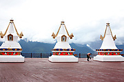 Painting the deck at Feilal Temple, Yunnan, China; September, 2013.