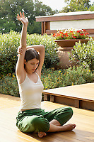 Young woman practising yoga portrait