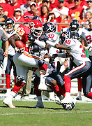 KANSAS CITY, MO - SEPTEMBER 26:  Running back Derrick Blaylock #23 of the Houston Texans runs into (left to right) rookie cornerback Dunta Robinson #23, cornerback Jason Simmons #30, and cornerback Demarcus Faggins #38 of the Kansas City Chiefs at Arrowhead Stadium on September 26, 2004 in Kansas City, Missouri. The Texans defeated the Chiefs 24-21. ©Paul Anthony Spinelli *** Local Caption *** Derrick Blaylock, Dunta Robinson, Jason Simmons