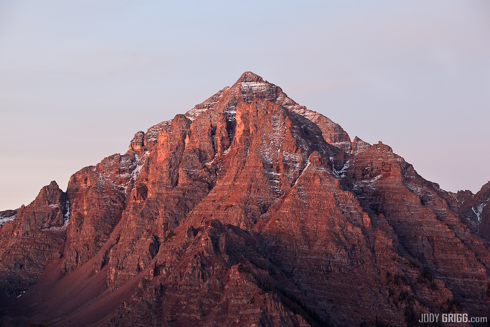 First light begins to illuminate Pyramid Peak, 14,018ft in the Maroon Bell-Snowmass Wilderness Area outside of Aspen.