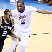 06 May 2016: San Antonio Spurs forward Kawhi Leonard (2) drives past Oklahoma City Thunder forward Kevin Durant (35) during the San Antonio Spurs 100-96 victory over the Oklahoma City Thunder, during Game Three of the Western Conference Semifinals of the NBA Playoffs at the Chesapeake Energy Arena, Oklahoma City, Oklahoma, USA.