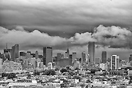 The Empire State Building pierces the clouds over Manhattan