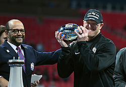 UCF Knights head coach Scott Frost celebrates after the second half of the Chick-fil-A Peach Bowl NCAA college football game at the Mercedes-Benz Stadium in Atlanta, January 1, 2018. UCF won 34-27 to go undefeated for the season. (David Tulis via Abell Images for Chick-fil-A Peach Bowl)