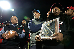 """2013 PIAA D12 AA High-school Football Championship, Benjamin L. Johnston Memorial Stadium, Northwest Philadelphia, PA, USA - November 15, 2013; PIAA district vice-chair and former GHS Bears head coach Michael Hawkins (center) presents Imhotep head coach Albie Crosby and CEO/Founder M. Christine Wiggins with the PIAA District 12 AA championship plaque.<br /> <br /> ( Photo is published earlier on WHYY's NewsWorks.org as part of the November 16, 2013 story by Brian Hickey: """"Imhotep Panthers win city's AA high-school football championship"""" - http://www.newsworks.org/index.php/nw-philadelphia-more-stories/item/61978-imhotep-charter-panthers-win-the-aa-city-high-school-football-championship )"""