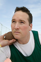 Male shot putter holding shot