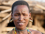 Portrait of a young Datoga woman with beauty scarring around her eyes. Photographed at Lake Eyasi, Tanzania