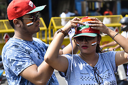 October 21, 2018 - Guwahati, Assam, India - Indian team supporter paints Indian flag on face outside the Barsapara Cricket Stadium in the day of India vs West Indies one day international  cricket match in Guwahati, Assam, India on Sunday, October 21, 2018. (Credit Image: © David Talukdar/NurPhoto via ZUMA Press)