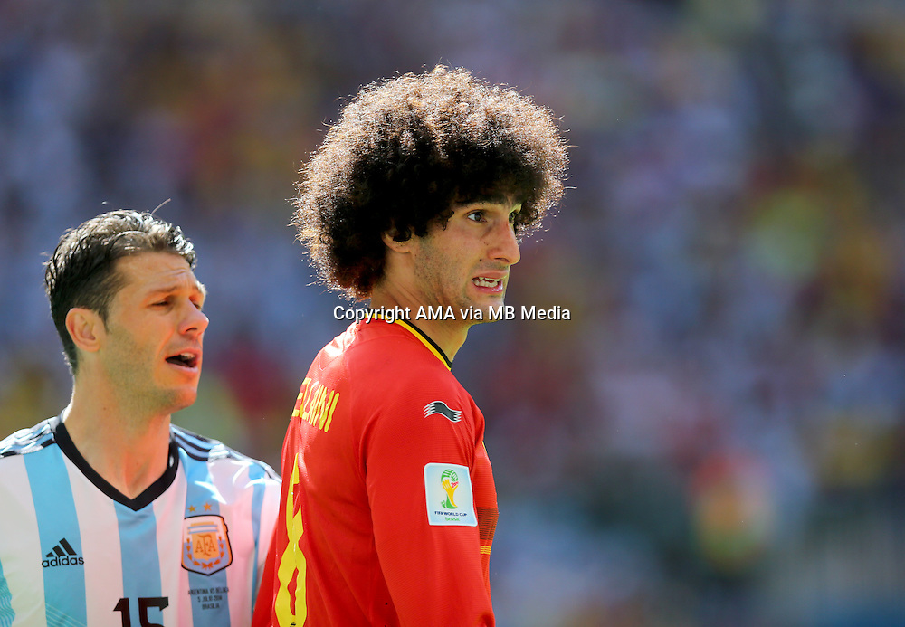 Martin Demichelis of Argentina and Marouane Fellaini of Belgium