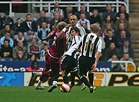 Photo: Andrew Unwin.<br /> Newcastle United v Bolton Wanderers. The Barclays Premiership. 15/10/2006.<br /> Newcastle's Emre (C) is booked for this challenge on Bolton's El-Hadji Diouf (L).