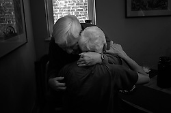 WASHINGTON, D.C., DECEMBER 28, 2013: Stephen Lee, 59, right, gets a hug from his uncle Royce Carroll, 69, who is visiting from North Carolina. Royce is the brother of Stephen's mother who died of Huntington's Disease when she was only 49 years old. Since there was a 50 percent chance that Royce would also have Huntington's he took the test but refused to learned the results of it. Since he has not shown any symptoms of the disease it is safe to say that he didn't inherit it. (Photo by Astrid Riecken)