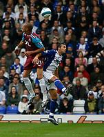Photo: Steve Bond.<br />Birmingham City v West Ham United. The FA Barclays Premiership. 18/08/2007. Bobby Zamora (L) wins the ball in the air