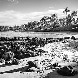 Keawakapu Beach black and white photo in Wailea Makena Maui Hawaii with lava rocks and the Pacific Ocean. Copyright ⓒ 2019 Paul Velgos with All Rights Reserved.