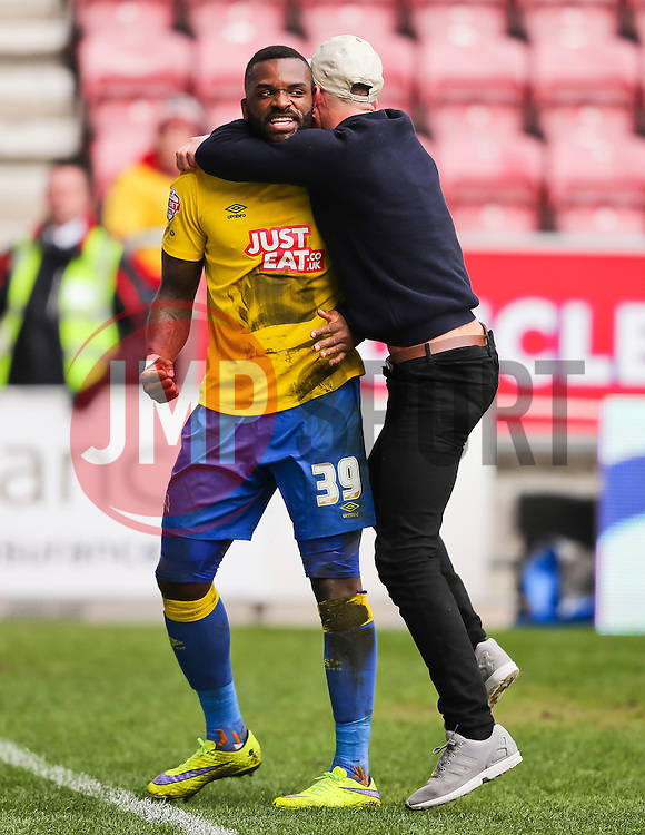Darren Bent of Derby County celebrates with a fan after scoring his sides second goal 0-2  - Photo mandatory by-line: Matt McNulty/JMP - Mobile: 07966 386802 - 06/04/2015 - SPORT - Football - Wigan - DW Stadium - Wigan Athletic v Derby County - SkyBet Championship