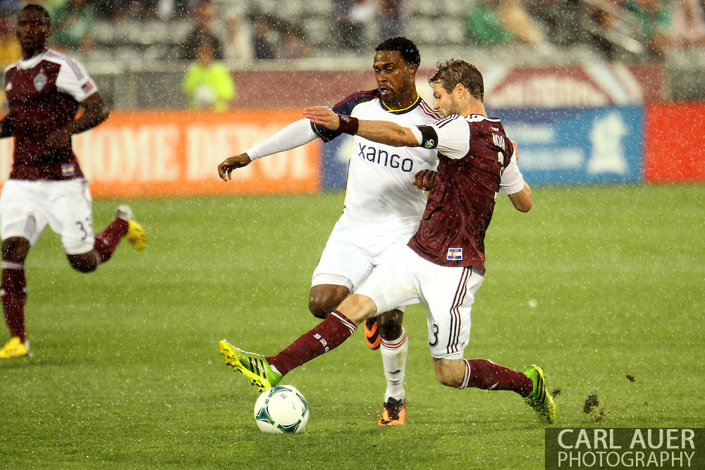 August 3rd, 2013 - Colorado Rapids defender Drew Moor (3) steals the ball from Real Salt Lake forward Robbie Findley (10) in the second half of action in the Major League Soccer match between Real Salt Lake and the Colorado Rapids at Dick's Sporting Goods Park in Commerce City, CO