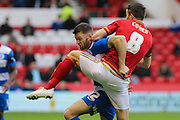 Queens Park Rangers forward Jamie Mackie and Nottingham Forest midfielder Chris Cohen challenge for the ball during The FA Cup third round match between Nottingham Forest and Queens Park Rangers at the City Ground, Nottingham, England on 9 January 2016. Photo by Aaron Lupton.