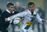 (L) Polonia's Aleksandar Todorovski and (R) Lechia's Piotr Wisniewski fight for the ball during T-Mobile Extraleague soccer match between Polonia Warsaw and Lechia Gdansk in Warsaw, Poland...Poland, Warsaw, February 22, 2013...Picture also available in RAW (NEF) or TIFF format on special request...For editorial use only. Any commercial or promotional use requires permission...Photo by © Adam Nurkiewicz / Mediasport