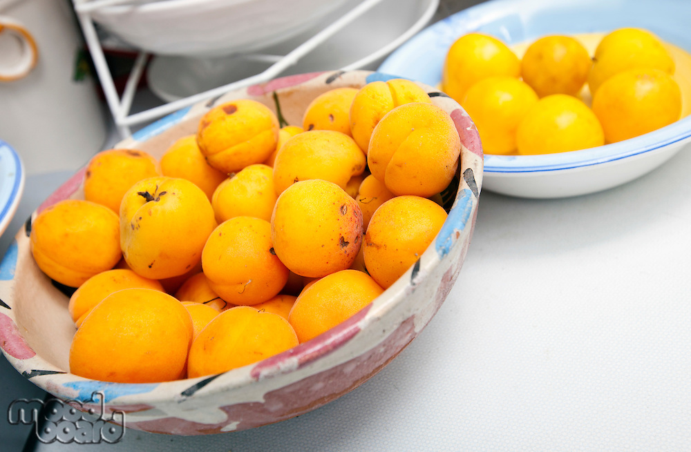 Yellow peaches in bowl at kitchen counter