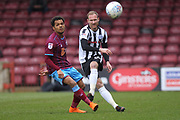 Matty Done passes the ball during the EFL Sky Bet League 1 match between Scunthorpe United and Rochdale at Glanford Park, Scunthorpe, England on 24 March 2018. Picture by Daniel Youngs.