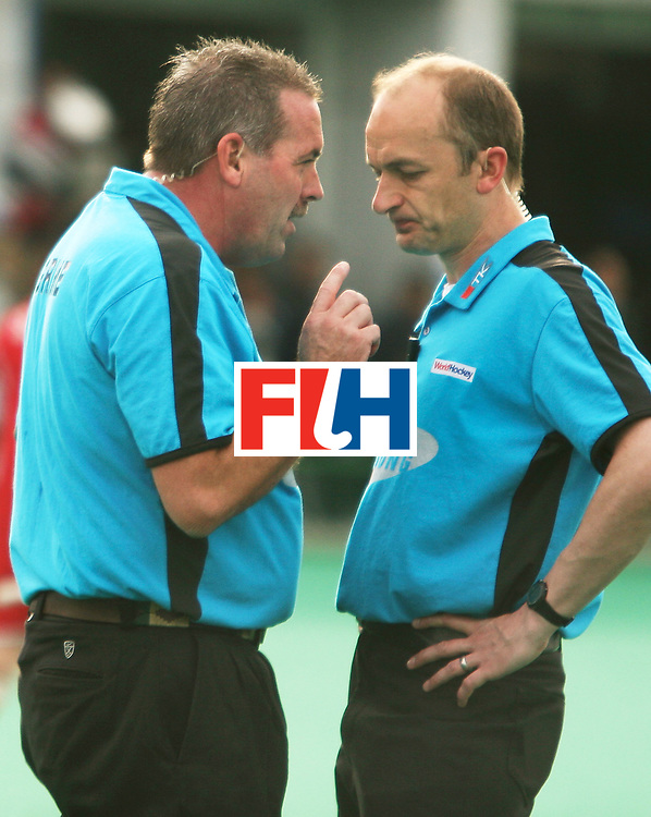 Kakamigahara (Japan):  Umpire grime Murray (left) seen in discussion with Jamson Hamish over the controversial goal equaliser scored by Japan against Malaysia in the Olympic Hockey Qualifier at Gifu Perfectural Green Stadium at Kakamigahara on 12 April 2008.  Photo: GNN/ Vino John