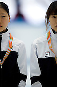 (L) Noh Do Hee (54) with silver medal and (R) Kim Alang (52 with gold medal both of South Korea in the Women's 1000 Meters on day three of the 2013 ISU Short Track Speed Skating Junior World Championships at Torwar Ice Hall on February 24, 2013 in Warsaw, Poland...Poland, Warsaw, February 24, 2013...Picture also available in RAW (NEF) or TIFF format on special request...For editorial use only. Any commercial or promotional use requires permission...Photo by © Adam Nurkiewicz / Mediasport