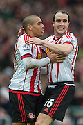 Sunderland's Defender John O'Shea and Sunderland's Midfielder Wahbi Khazri celebrate the winning goal during the Barclays Premier League match between Sunderland and Manchester United at the Stadium Of Light, Sunderland, England on 13 February 2016. Photo by George Ledger.