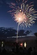 Middletown, NY  - Fireworks explode in the sky over the lake at Fancher-Davidge Park on June 30, 2007.