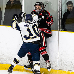 TORONTO, ON - APR 10, 2018: Ontario Junior Hockey League, South West Conference Championship Series. Game seven of the best of seven series between the Georgetown Raiders and the Toronto Patriots, Kyler Matthews #10 of the Toronto Patriots crushes Derek McVey #8 of the Georgetown Raiders into the boards during the first period.<br /> (Photo by Kevin Raposo / OJHL Images)