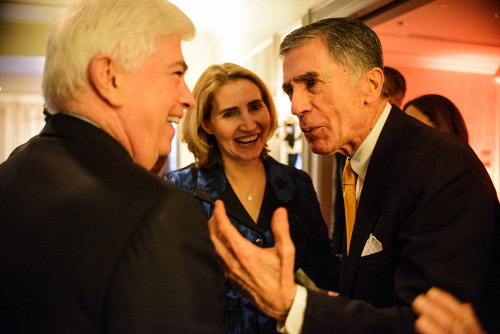 """Photo by Matt Roth.Assignment ID: 10137379A..Chris Dodd, left, Jackie Clegg Dodd, and Chuck Robb, talk during the Buffy and Bill Cafritz, Ann and Vernon Jordan, Vicki and Roger Sant inaugural """"Bi-Partisan Celebration"""" at the Dolley Madison Ballroom at the Madison Hotel in Washington, D.C. on Monday, January 21, 2013."""