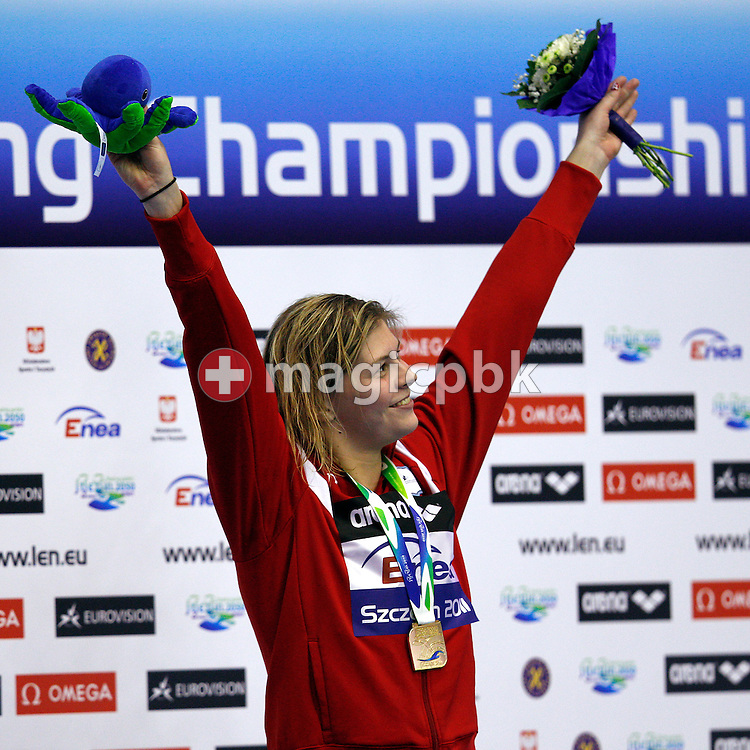 Lotte FRIIS of Denmark celebrates on the podium during the award ceremony after winning the women's 800m Freestyle during the 15th European Short Course Swimming Championships in Szczecin, Poland, Friday, Dec. 9, 2011. (Photo by Patrick B. Kraemer / MAGICPBK)