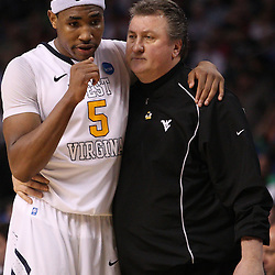 Mar 17, 2011; Tampa, FL, USA; West Virginia Mountaineers head coach Bob Huggins and forward Kevin Jones (5) during the second half of the second round of the 2011 NCAA men's basketball tournament at the St. Pete Times Forum. West Virginia defeated Clemson 84-76.  Mandatory Credit: Derick E. Hingle