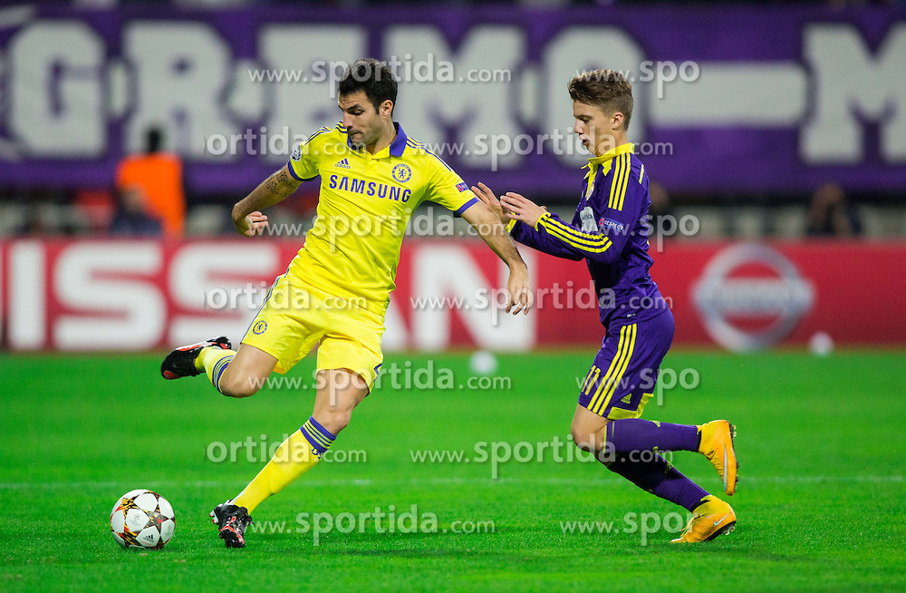Cesc Fàbregas of Chelsea vs Luka Zahovic of Maribor during football match between NK Maribor, SLO  and Chelsea FC, ENG in Group G of Group Stage of UEFA Champions League 2014/15, on November 5, 2014 in Stadium Ljudski vrt, Maribor, Slovenia. Photo by Vid Ponikvar / Sportida