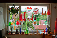 Our beautiful art glass displayed in our living room window.