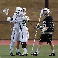 Staff photos by Tom Kelly IV<br /> Ridley's Devon Tavani (25) congratulates Brock Anderson (2) on his long range goal in the first half as Strath Haven's Nick Pappas (23) looks on during the Strath Haven at Ridley boys lacrosse game on Thursday afternoon, March 26, 2015.