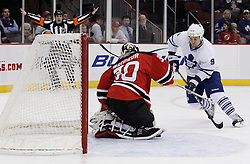 Jan 29, 2010; Newark, NJ, USA; New Jersey Devils goalie Martin Brodeur (30) makes a save on Toronto Maple Leafs left wing Niklas Hagman (9) during the first period at the Prudential Center.