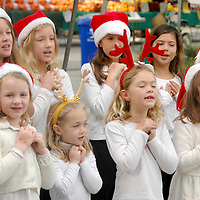 The Santa Monica Alternative School House children's choir perform at the Santa Monica Main Street Farmers Market on Sunday, December 5, 2010.