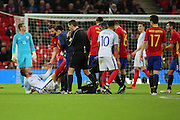 England midfielder Eric Dier (04) down injured during the Friendly match between England and Spain at Wembley Stadium, London, England on 15 November 2016. Photo by Matthew Redman.