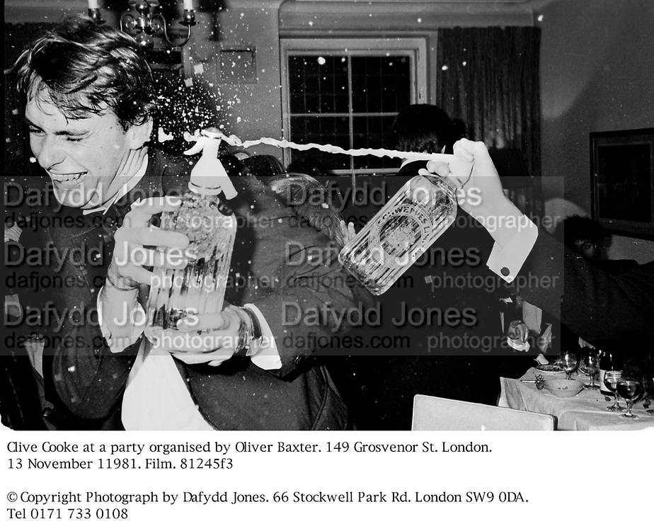 Clive Cooke at a party organised by Oliver Baxter. 149 Grosvenor St. London. 13 November 11981. Film. 81245f3<br />