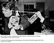 Clive Cooke at a party organised by Oliver Baxter. 149 Grosvenor St. London. 13 November 11981. Film. 81245f3<br />&copy; Copyright Photograph by Dafydd Jones. 66 Stockwell Park Rd. London SW9 0DA. Tel 0171 733 0108