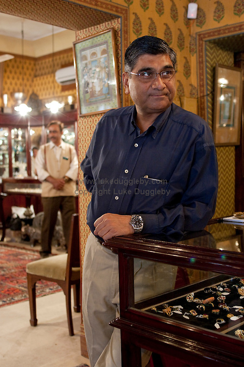 Sudhir Kasliwal, brother of the shop owner stands in the shop waiting to serve customers. Jaipur's Gem Palace was established in 1852 by the Kasliwal family of Jaipur. In the jewel business for over eight generations, the Kasliwals were once the court jewellers of Moghul emperors. The Gem Palace's reputation remains intact today: the Metropolitan Museum in New York has assigned a permanent window for the Gem Palace to display its products, the only jewellery maker ever to get this honour. .Previous clients that have travelled half way around the world to buy from the palace include Lord and Lady Mountbatten, the Prince and Princess of Wales, Mick Jagger, Angelina Jolie and the Queen of Spain to name but a few.