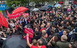 © Licensed to London News Pictures. 18/05/2017. London, UK. Labour party leader Jeremy Corbyn is surrounded by local people as he addresses a campaign rally in Southall on the same day that Prime Minister Theresa May launched the Conservative Party manifesto. Photo credit: Peter Macdiarmid/LNP