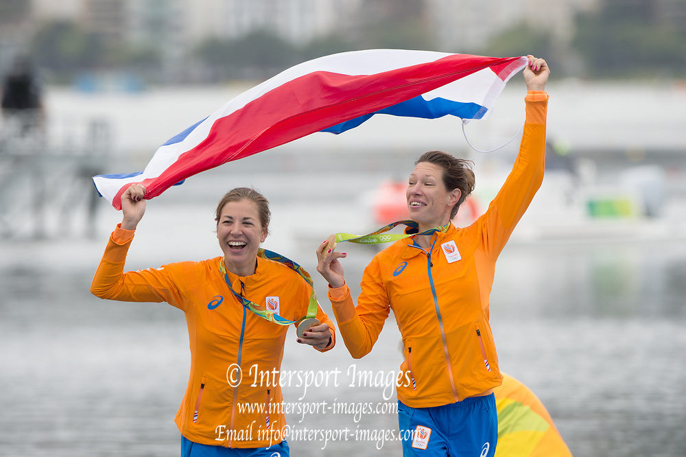 Rio de Janeiro. BRAZIL. Gold Medalist NED LW2X. Bow. Ilse PAULIS, and Maaike<br /> HEAD,celebrate after receiving their Gold Medals, 2016  2016 Olympic Rowing Regatta. Lagoa Stadium,<br /> Copacabana,  &ldquo;Olympic Summer Games&rdquo;<br /> Rodrigo de Freitas Lagoon, Lagoa. Local Time 11:05:28  Friday  12/08/2016 <br /> [Mandatory Credit; Peter SPURRIER/Intersport Images]