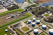 Nederland, Groningen, Delfzijl, 01-05-2013; zeesluis van het Eemskanaal met het zeehavenkanaal. De sluis maakt onderdeel uit van de vaarroute Lemmer-Delfzijl. Olietanks, opslag olie en benzine.<br /> Sealock of the Eemskanaal, the port of Delfzijl.<br /> luchtfoto (toeslag op standard tarieven);<br /> aerial photo (additional fee required);<br /> copyright foto/photo Siebe Swart