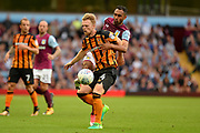 Aston Villa Aston Villa defender Ahmed Elmohamady (27) manages to get a boot to the ball round Hull City defender Max Clark (24) during the EFL Sky Bet Championship match between Aston Villa and Hull City at Villa Park, Birmingham, England on 5 August 2017. Photo by Dennis Goodwin.