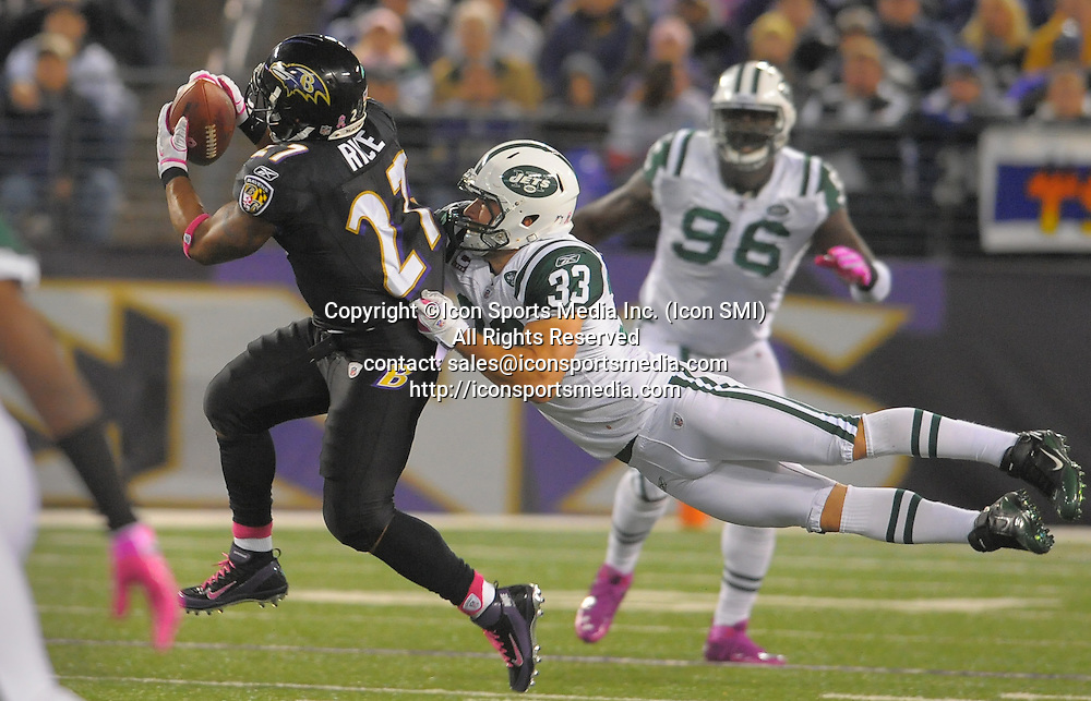 Oct. 2, 2011 - Baltimore, MD, USA - Baltimore Ravens running back Ray Rice takes a short pass that results in big yardage while being defended by New York Jets free safety Eric Smith during the first half of their game on Sunday, October 2, 2011, in Baltimore, Maryland
